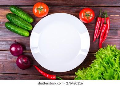 vegetables fresh near a plate