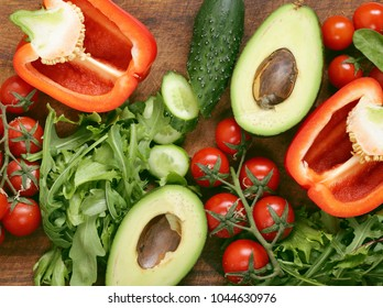 vegetables for fresh salad on a wooden table