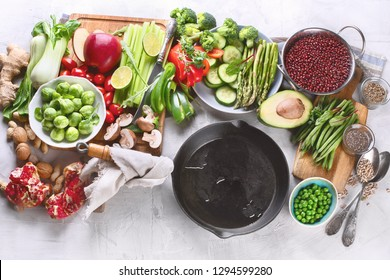 Vegetables, fruit, cereals, beans,  superfoods for vegan, vegetarian, clean eating diet.  Diet food concept. Healthy food background