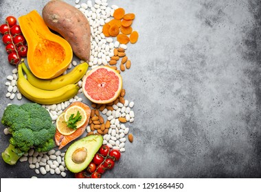 Vegetables, fruit and foods containing potassium, stone background, top view, space for text. Natural sources of potassium, vitamins and micronutrients, healthy balanced diet, avitaminosis prevention