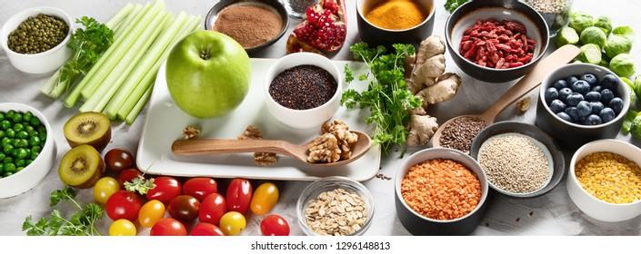 Vegetables, fruit, grain, superfoods for vegan and vegetarian eating. Clean eating. Detox, dieting food concept. Panorama, banner