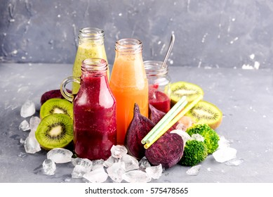 Vegetables and fruit smoothie in bottle Ice and fruit and vegetables around bottle