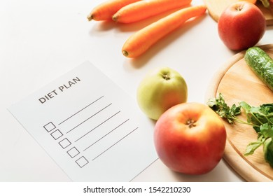 Vegetables and fruits and diet plan isolated on table in kitchen close-up