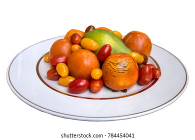 Vegetables and fruits: finger tomatoes of different colors, persimmon and papaya isolated on white background for vegans and vegetarians ready for product display or montage.