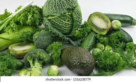 Vegetables and fruits of  green color on the white background. Healthy food.