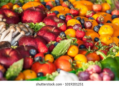 Vegetables, fruits and herbs blurred for the background.