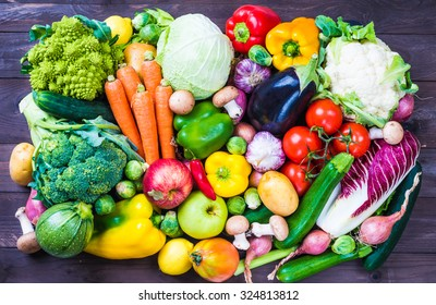 Vegetables and fruits on rustic wooden background.