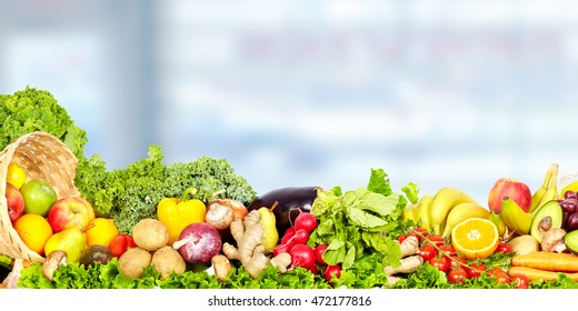 Vegetables and fruits over blue background.