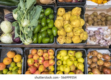 Vegetables and fruits in rustic plastic box top view. Healthy eating, cooking. Market of Tarifa in Andalusia, Spain