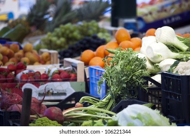 Vegetables and fruits at stalls in the Italian market