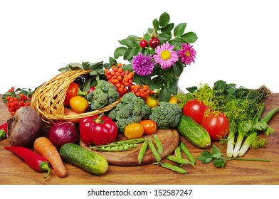 Vegetables, grapes and flowers. Isolated on white