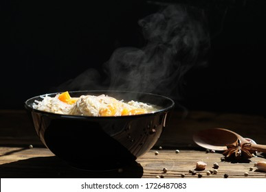 vegetables and ground pork, I steaming. a bowl of hot food on wood table on black background. hot food concept