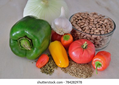 Vegetables, herbs and beans before they are combined in a cook pot to make Chili.