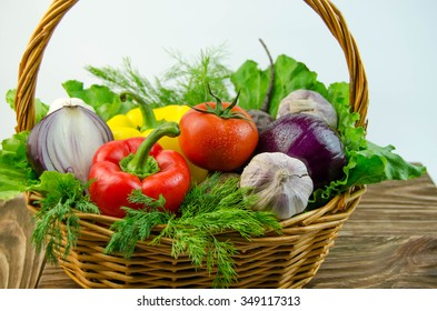 Vegetables and herbs in a wicker basket