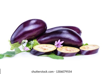 Vegetables isolated on white background. Fresh eggplants from flower beds, with leaves and flowers on a white background. Sliced eggplant isolated.Creative layout fresh eggplants.