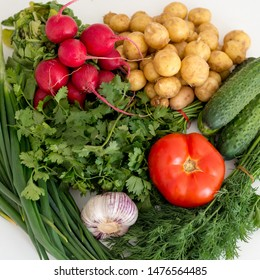 Vegetables lie on a white background, greens, tomato, potato