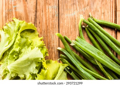 Vegetables located on textured wood background as concept for weight loss and healthy lifestyle
