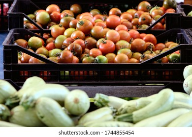 Vegetables at the market: focus on a basket of camone tomatoes