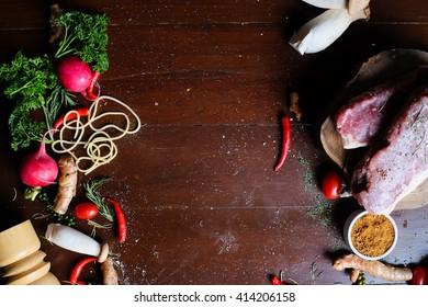Vegetables & Meat on Wood Table. Vegetables on wood