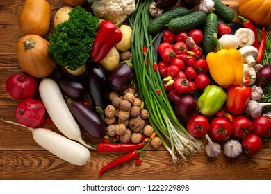 Vegetables and nuts on a brown wooden background