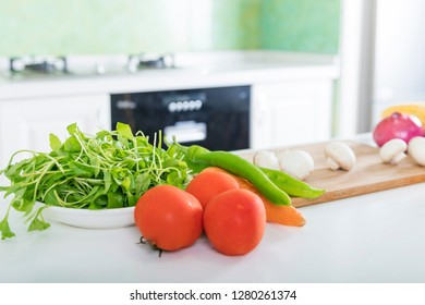 Vegetables on the dining table in the modern kitchen