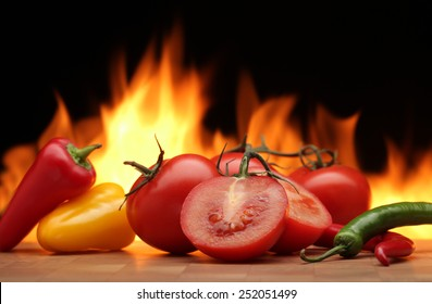 Vegetables  on  fire  background