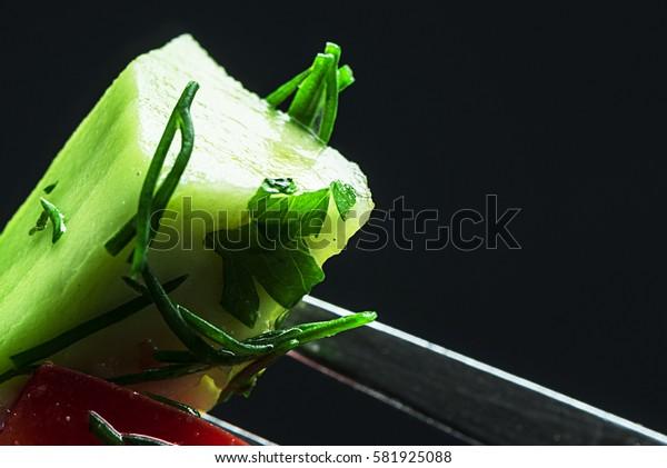 Vegetables on a fork, close-up. Focus on vegetables