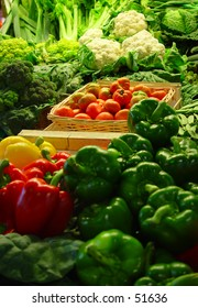 vegetables on a market stand (slightly shallow depth of field, focus is on tomatoes)