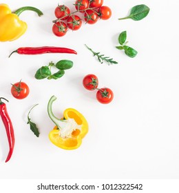 Vegetables on white background. Frame made of fresh vegetables. Tomatoes, peppers, green leaves. Flat lay, top view, copy space, square