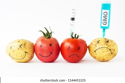 Vegetables on a white background potatoes and tomatoes with nitrates and gmo, syringe, close-up, genetically modified organism