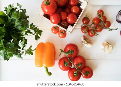 Vegetables on white wooden. Bio healthy food, herbs and spices. Organic vegetables. Wooden rural table and ingredients on light background. Vegetarian food, cooking concept.
