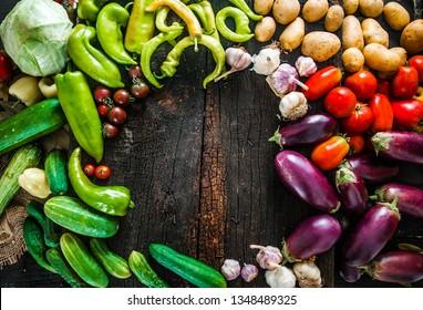 Vegetables on wood. Organic vegetables in rustic setting. Fresh food. Healthy veggies. Overhead shot