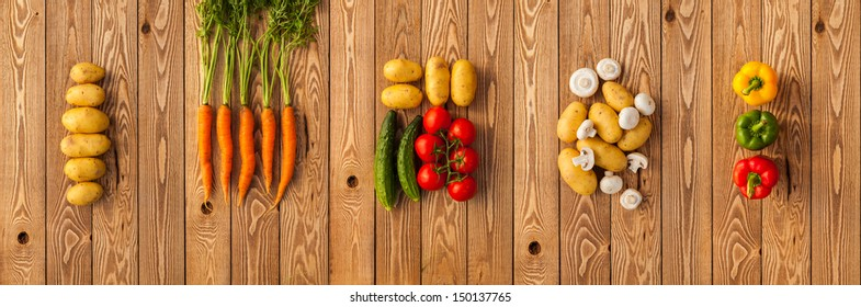 Vegetables on a wooden background. Panorama
