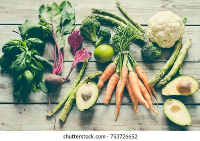 Vegetables on a wooden background/toned photo