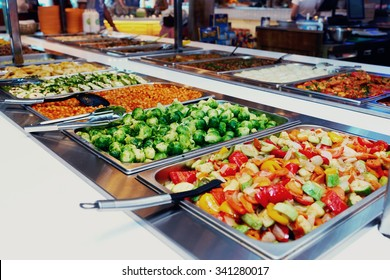 Vegetables and other foods in free-flo restaurant, toned image