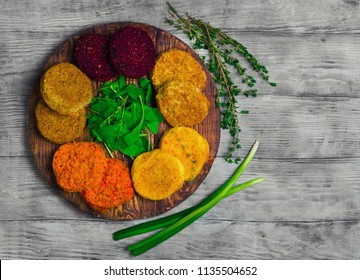 Vegetables patties (cutlets) for vegan burgers in bowl. Mix Vegetables stack fresh burgers. Spices for patties (cutlets) thyme, arugula. Gray wooden background. Top view