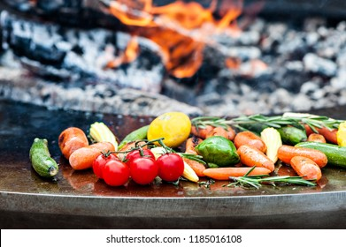Vegetables preparing on grill. On the background of fire.Selective focus.