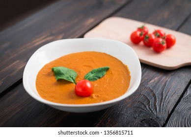 Vegetables (pumpkin, carrot) cream soup on wooden background