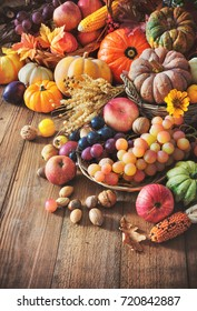 Vegetables pumpkins and fruits in autumn thanksgiving still life on wooden table