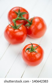 Vegetables: red tomatoes, vertical shot