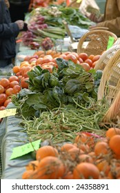 Vegetables for sale at a outdoor market.