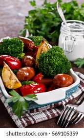 Vegetables with sausage and lemon. Selective focus.