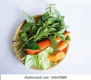 Vegetables set - diet food for health - green sweet basil ( Thai basil ), white cabbages and orange carrots isolated on white background