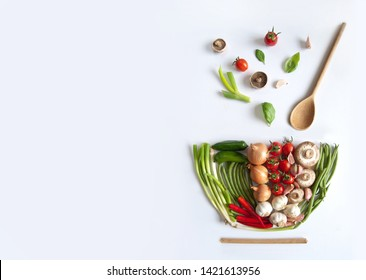 Vegetables in the shape of a soup bowl with wooden spoon