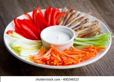 Vegetables sliced julienne, strips with sour cream dip, tatsy summer appetizer salad