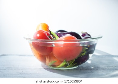 Vegetables soaked in water in a heat-resistant bowl (tomatoes, green beans, eggplants, carrots)