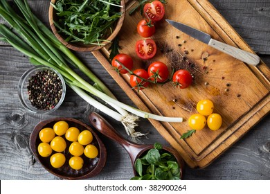 Vegetables and spices on wooden table