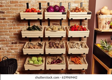 Vegetables stacked in large wooden boxes