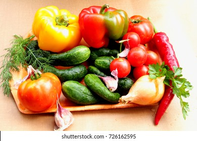 Vegetables. In the summer season, a lot of vegetables: juicy, red tomatoes, sweet, tasty peppers, crispy, green cucumbers. All this together produces a tasty, healthy salad.