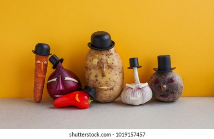 Vegetables team. Mister potato red onion beetroot garlic pepper carrot. Old fashion style characters organic plants, funny faces black hats. Yellow wall background. Vegetarian food concept.